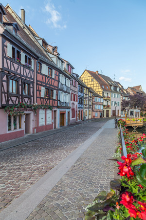 COLMAR, FRANCE - 30TH JULY 2016: A view of colourful timber framed buildings along Little Venice in Colmar during the morning