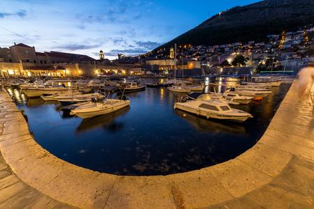 old port: DUBROVNIK, CROATIA - 11TH AUGUST 2016: Boats docked in the Dubrovnik Old Port at dusk. Editorial