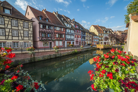 little venice: COLMAR, FRANCE - 30TH JULY 2016: A view of colourful timber framed buildings along Little Venice in Colmar during the morning. Reflections can be seen in the River Lauch