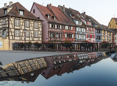 little venice: COLMAR, FRANCE - 30TH JULY 2016: A view of colourful timber framed buildings along Little Venice in Colmar. Reflections can be seen.