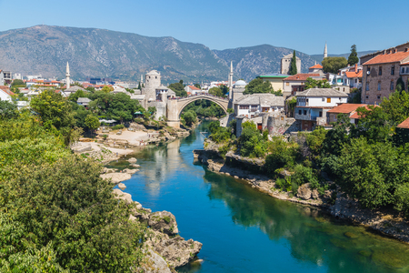 neretva: A view of the Mostar skyline during the day towards the Old Bridge (Stari Most). Buildings and the River Neretva can be seen.