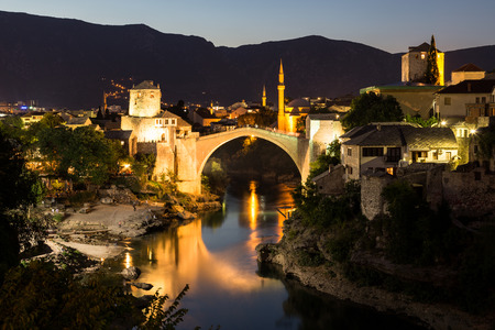 old bridge: A view of the Mostar skyline at night towards the Old Bridge (Stari Most). Buildings and the River Neretva can be seen.