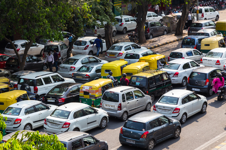 traffic jams: DELHI, INDIA - 19TH MARCH 2016: Traffic jams in central India during the day. Tuk Tuk Rickshaws, motorbikes, cars and people can be seen.