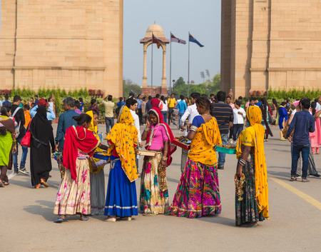 india gate: DELHI, INDIA - 19TH MARCH 2016: A group of women who are selling merchandise on the street near India Gate in Delhi during the day. Editorial