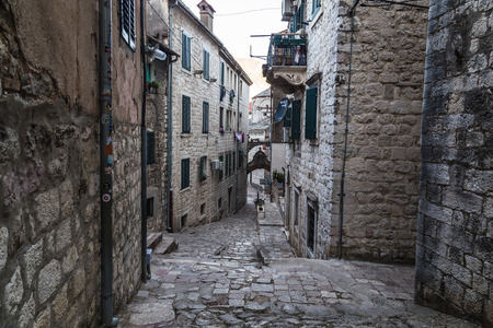 balk: KOTOR, MONTENEGRO - 13TH AUGUST 2016: Streets of Old Town Kotor during the day, showing the outside of buildings.
