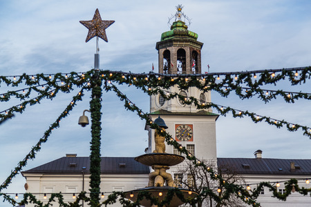 residenz: SALBURG, AUSTRIA - 11TH DECEMBER 2015: Decorations and the Neue Residenz at Salzburg Christmas Market in the Residenzplatz area during the day