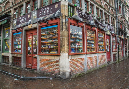 GHENT, BELGIUM, 18TH FEBRUARY 2016: The outside of a beer store in Ghent. Large amounts of beer can be seen on display.
