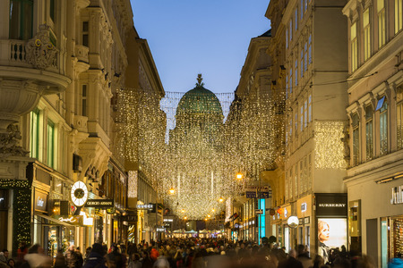 lots people: VIENNA, AUSTRIA - 2ND DECEMBER 2016: A view along Kohlmarkt in Vienna at Christmas. Lots of people, decorations and the outside of shops can be seen. Editorial