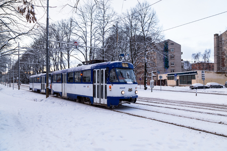developed: RIGA, LATVIA - 3RD JAN 2017: Trams in Riga during the day in the winter. Lots of snow can be seen. Editorial