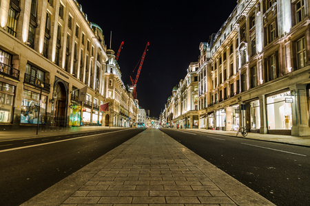 regent: LONDON, UK - 8TH MARCH 2015:  Regent Street in central London at night showing the architecture and outside of buildings.