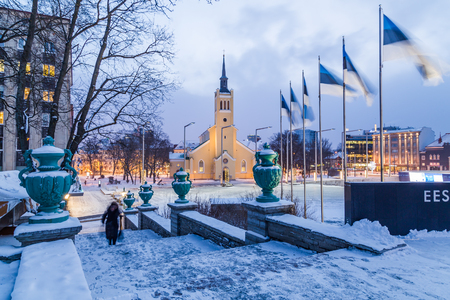 TALLINN, ESTONIA - 5TH JAN 2017:  A view towards St. Johns Church in Tallinn during the morning in the winter. People can be seen. Editorial