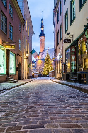 TALLINN, ESTONIA - 4TH JAN 2017: Raekoja plats, Old Town Hall Square in Tallinn in the morning during the festive period. Christmas decorations, market stalls and people can be seen.