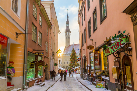 TALLINN, ESTONIA - 5TH JAN 2017: Raekoja plats, Old Town Hall Square in Tallinn in the morning during the festive period. Christmas decorations, market stalls and people can be seen.