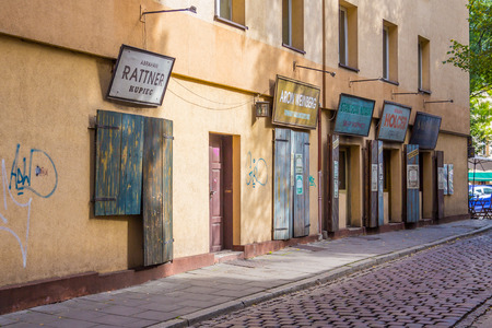 szeroka: KRAKOW, POLAND -  15TH OCTOBER 2016: Historics shops along Szeroka in the Kazimierz district of Krakow.
