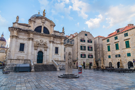 11th: DUBROVNIK, CROATIA - 11TH AUGUST 2016: A view of quiet streets in Dubrovnik during the morning. Church of Saint Blaise and other buildings can be seen.