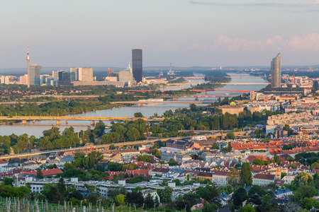 VIENNA, AUSTRIA - 7TH MAY 2016: Part of the Vienna Skyline from kahlenberg showing buildings, bridges and the River Danube.
