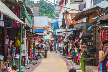 KO PHI PHI DON, THAILAND - 1ST APRIL 2017: Streets of Ko Phi Phi Don in South Thailand during the day. The outside of shops and people can be seen.