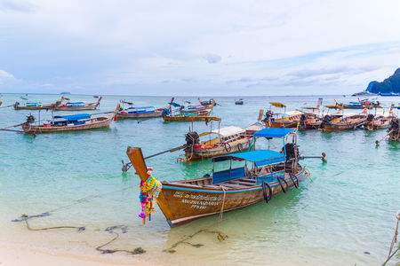 KO PHI PHI DON, THAILAND - 1ST APRIL 2017: Beaches, hills and typical long-tail boats in Ko Phi Phi Thailand during the day.