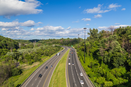 TORONTO, CANADA - 23RD JUNE 2015: A view of cars on the Don Valley Parkway (DVP) in Toronto during the day