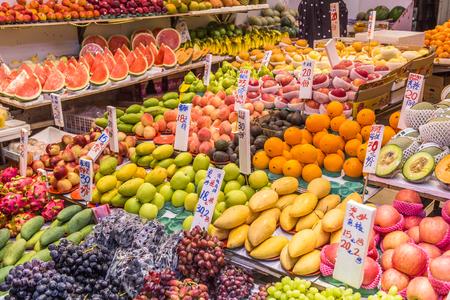 HONG KONG, HONG KONG - 9TH APRIL 2017: Closeup to a stall in Hong Kong selling a large variety of colourful fruit