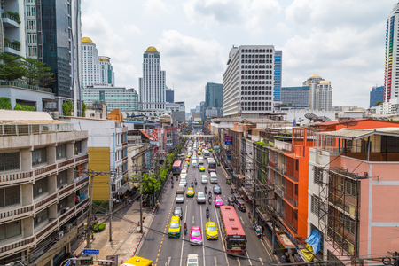 BANGKOK, THAILAND - 16TH MARCH 2017: A view along roads in central Bangkok during the day showing large amounts of traffic and the outside of buildings