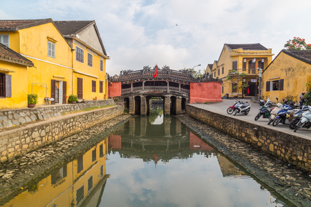HOI AN, VIETNAM - 25TH MARCH 2017: The Japanese Bridge in Old Town Hoi An during the morning. Other buildings can be seen. Editorial
