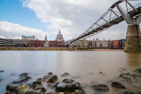 LONDON, UK - 24TH MARCH 2015: St Pauls Cathedral and Millenium Bridge in London during the day. Taken with a long exposure Editorial