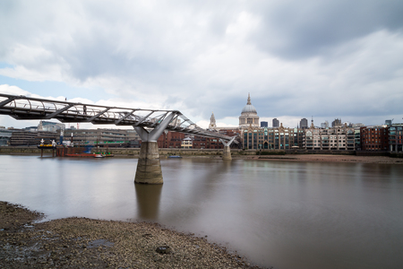 St Pauls Cathedral and Millenium Bridge in London during the day. Taken with a long exposure