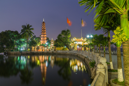 HANOI, VIETNAM,  19TH MARCH 2017: A view towards the Tran Quoc Pagoda in Hanoi Vietnam at night