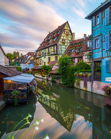 COLMAR, FRANCE - 31ST JULY 2016: La Petite Venise in Colmar at sunset. Buildings,architecture and people can be seen.