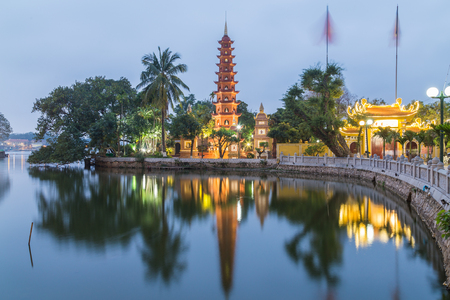 HANOI, VIETNAM,  19TH MARCH 2017: A view towards the Tran Quoc Pagoda in Hanoi Vietnam just after sunset