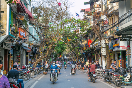 HANOI, VIETNAM, 20TH MARCH 2017: Streets of the Old Quarter of Hanoi during the day. Lots of people and traffic can be seen.