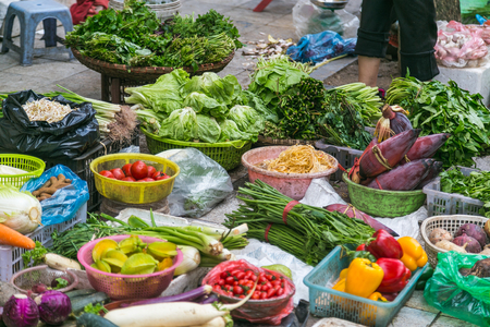 Large amounts of vegetables on display at a stall in Hanoi, Vietnam. Stock Photo