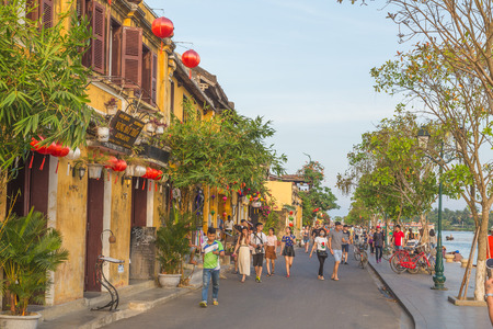HOI AN, VIETNAM - 24TH MARCH 2017:  Large amoutns of people along streets of Hoi An Ancient Town during the day