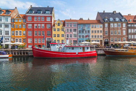 atmosphere: COPENHAGEN, DENMARK - 23RD MAY 2017: A view along the  Nyhavn during the day. Lots of architecture and boats can be seen.