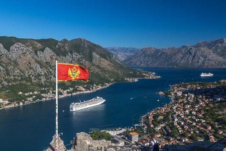 KOTOR, MONTENEGRO - 13TH AUGUST 2016: V view of the Kotor skyline in the morning in the summer. An MSC Cruise liner can be seen. Editorial