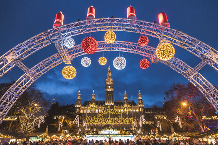 VIENNA, AUSTRIA - 17TH DECEMBER 2017: The outside of the Christmas Market at Rathaus in Vienna at night. Decorations, market stalls and lots of people can be seen. Editorial