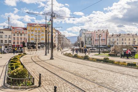 SOFIA, BULGARIA - 2ND APRIL 2018:  A view of streets, buildings during the day in Sofia, the capital city of Bulgaria. People can be seen.