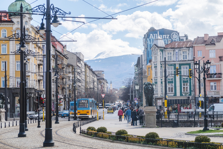 SOFIA, BULGARIA - 2ND APRIL 2018:  A view of streets, trams, buildings during the day in Sofia, the capital city of Bulgaria. People can be seen.