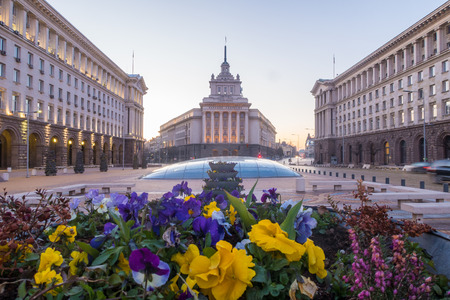 SOFIA, BULGARIA - 3RD APRIL 2018: The outside of the buildings at the Largo in Sofia. Showing the Party House,  TZUM department store and flowers in the foreground Editorial