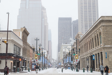 CALGARY, CANADA -  3TH MARCH 2018: A view along Stephen Avenue Walk in Calgary during the day in the winter. Showing snow, architecture, roads and people