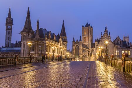 A view towards Saint Nicholas' Church in Ghent City Center at dusk. A cobbled road can be seen leading towards the landmark. Zdjęcie Seryjne