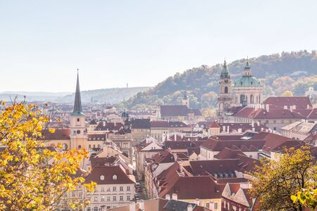 A view of the Prague skyline in the Mala Strana district of the city. Taken in the autumn months so colorful trees can be seen.