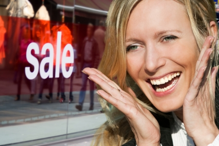 young and beautiful blond woman likes sale offers Stock Photo