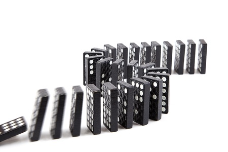 domino effect, black wooden domino line curve  photo