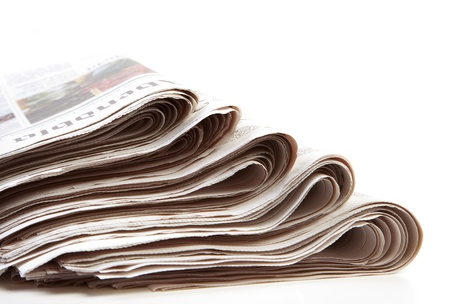 stack of newspaper Editorial
