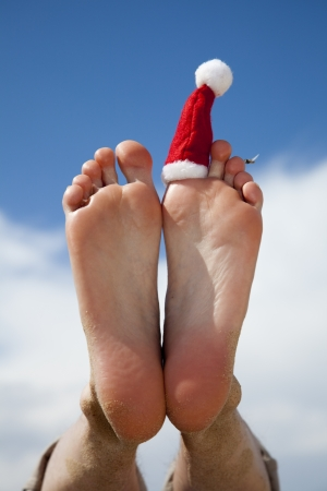 beach feet: christmas vacation Stock Photo