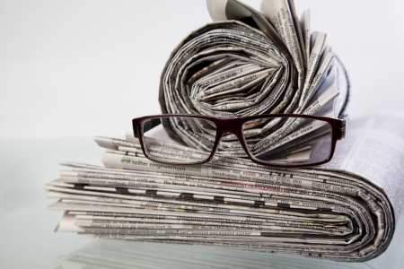 newspaper with reading glasses photo