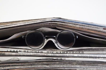 newspaper with reading glasses Stock Photo - 17850111