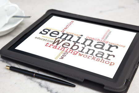 multicast: tablet with webinar word cloud Stock Photo